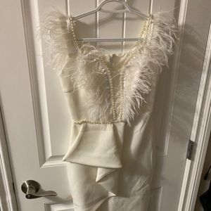 White dress with feather and bead detail